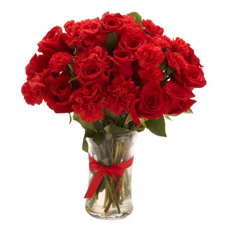 Red carnations and roses arrangement bouquet