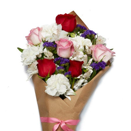 Wrapped flowers same day delivery with red roses, pink roses and carnations