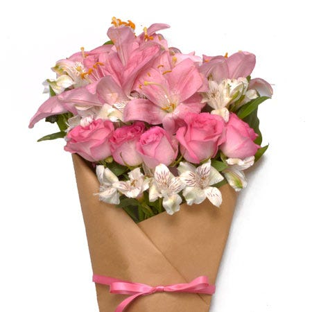Paper wrapped pink rose, pink lily, and white alstroemeria bouquet