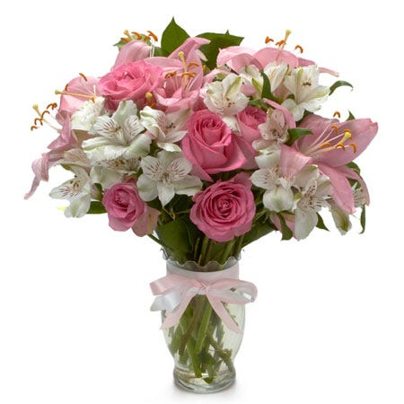 Spring flower bouquet with pink roses, pink lily and white alstroemeria