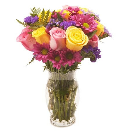 Mixed yellow and pink roses with pink daisies