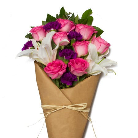 Mixed wrap rose bouquet delivery with cheap pink roses, purple carnations in vase