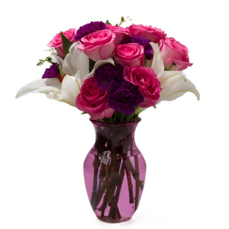 Pastel flower bouquet with hot pink roses, white lily, and purple carnations