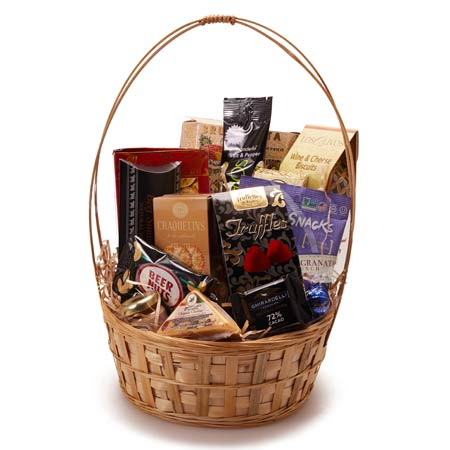 Chocolate cheese and cracker gifts basket inside a handled woven basket