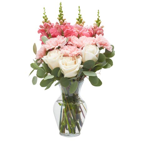 Pale pink and coral snapdragon flower bouquet with pink roses and vase