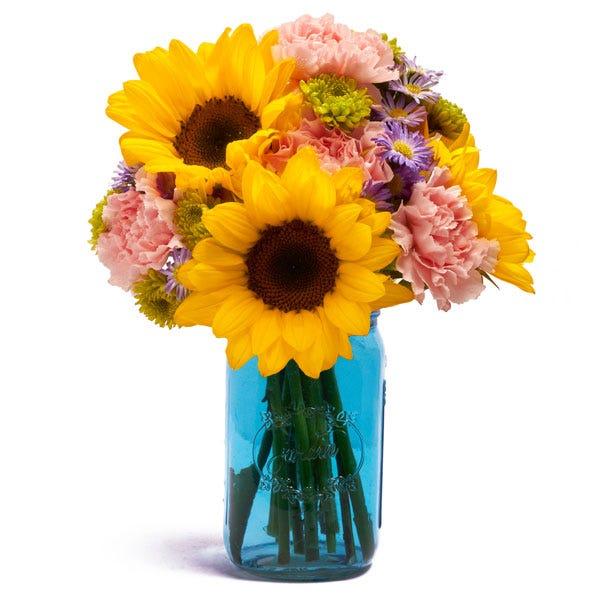 Blue mason jar sunflower arrangement, flowers in a mason jar bouquet