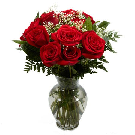 10 red roses with white babies breath and greens in a clear glass vase