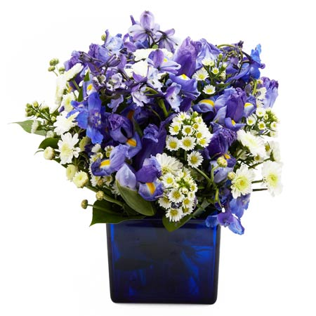 Blue flower bouquet with blue iris and white daisies and white carnations