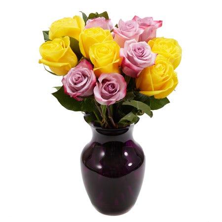 Purple and yellow rose bouquet arrangement