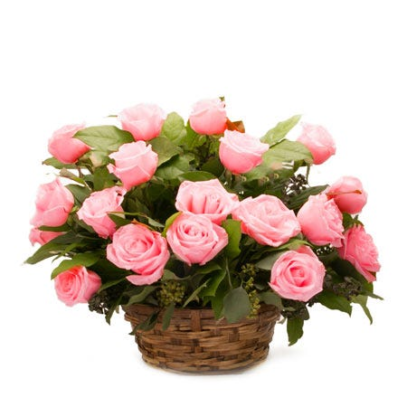 Pink roses basket bouquet in a woven basket with a card message