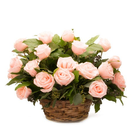 Light pink rose basket flower arrangement with woven basket and card message