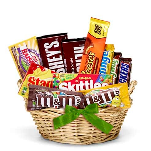 St pattys day gift basket delivery in a chocolate gift basket with candy, snacks and with a green bow