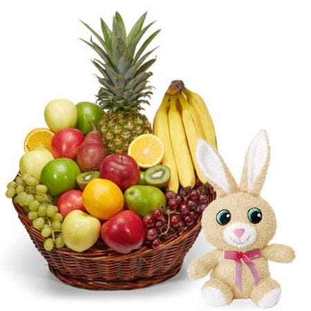 Mixed pineapple and fruits Easter gifts basket with a stuffed animal bunny toy