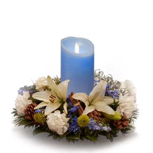 Blue candle and flower centerpiece with white lily and blue delphinium