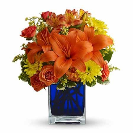 Orange lily and rose bouquet with orange lilies, roses and blue glass vase