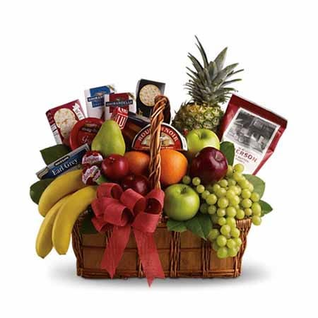 Gourmet fruit basket with fruits, cheese and crackers, chocolate and snacks