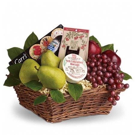 Pears, cheese, fruit, and grapes in a basket