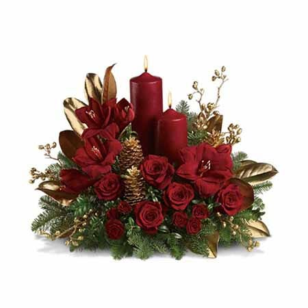 Holiday Amaryllis and red rose candle flower centerpiece with gold spray leaves