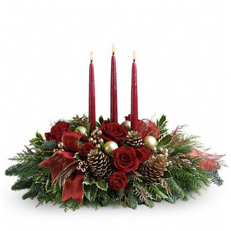 Red candle flower centerpiece with red roses, pinecones and christmas flowers