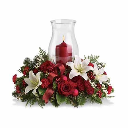 White lily and red rose centerpiece of winter white flowers