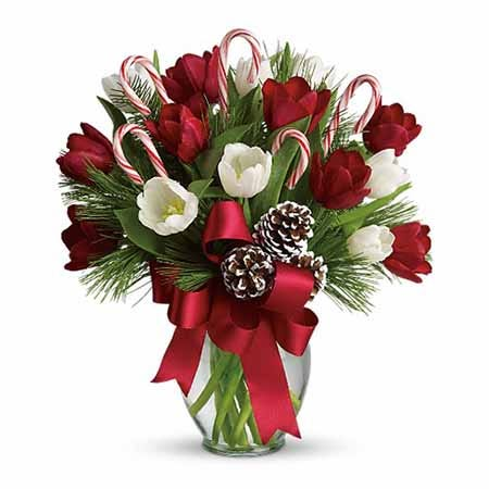 Red tulips, white tulips and candy cane bouquet