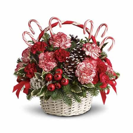 Christmas flower arrangement idea with candy canes and red white carnations