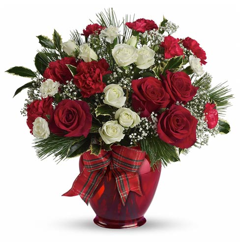 christmas flower arrangement idea with red roses and christmas flowers with bow