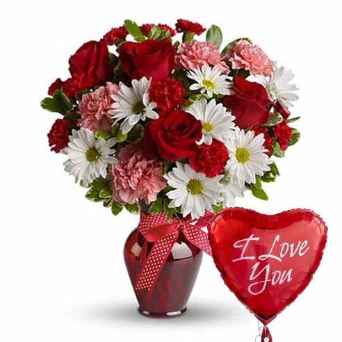 I love you balloon with red roses, pink carnations and white daisies in a red vase
