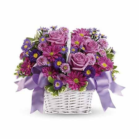 Purple roses, purple asters and purple Chrysanthemums in a white basket