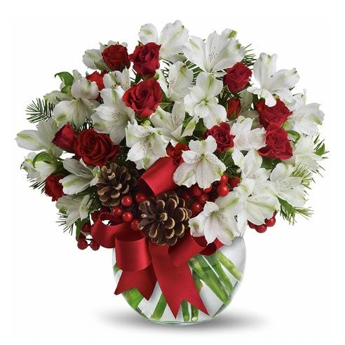 White alstroemeria bouquet with red spray roses with pine cones in a vase