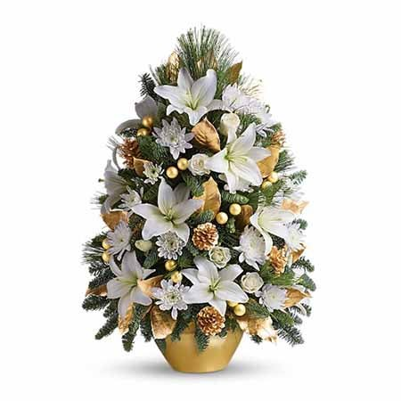 White lilies in a tiny christmas tree flower arrangement from send flowers
