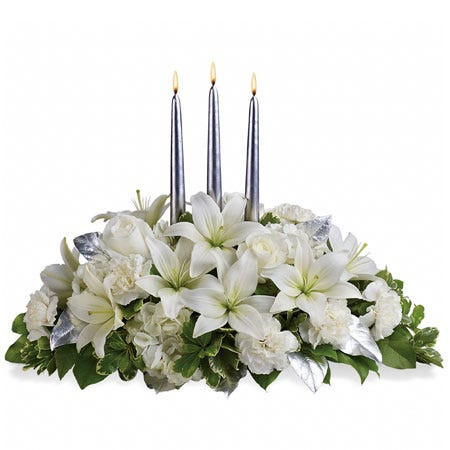 White lily centerpiece with white lilies, white hydrangea and carnations and candles
