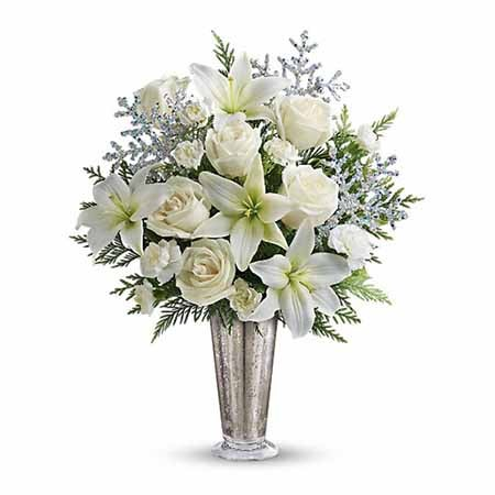 Winter white flowers in a white lily bouquet