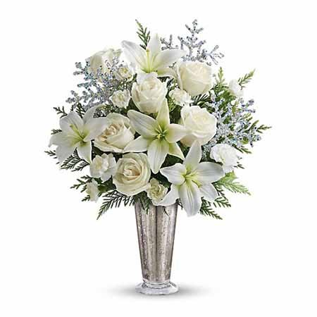 White lily and white roses winter flowers bouquet with sparkle silver vase