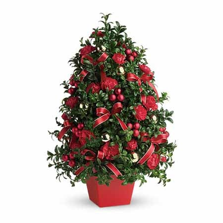 Mini christmas tree with flowers for christmas flower delivery same day