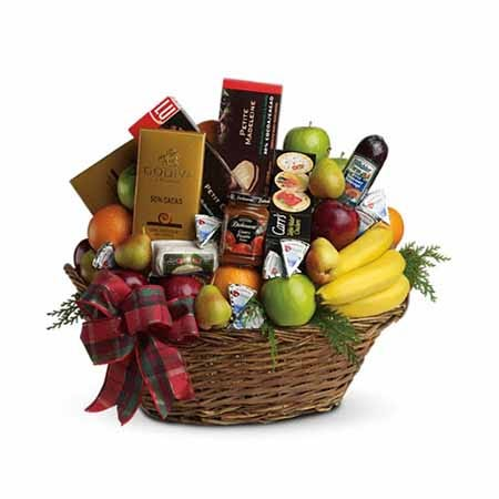 Chocolate and fruit gifts basket with chocolate, bananas, pears and oranges