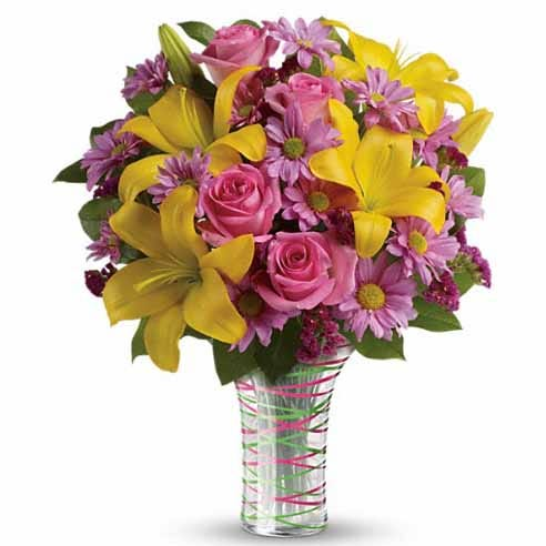 Candy pink and yellow flower bouquet with glass vase