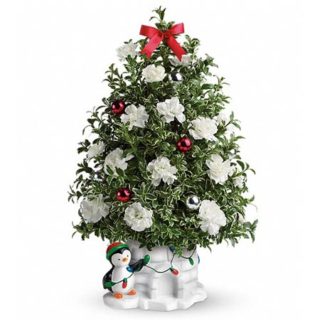 Christmas tree with flower from sendflowers with white carnations & penguin