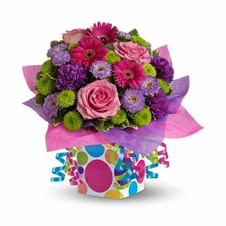 Multicolored confetti bouquet with multicolored flowers and party ribbon