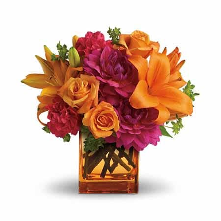 Orange flower bouquet with orange lily, orange roses, orange vase