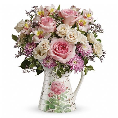 Floral print water pitcher with light-pink roses and pastel spring flowers