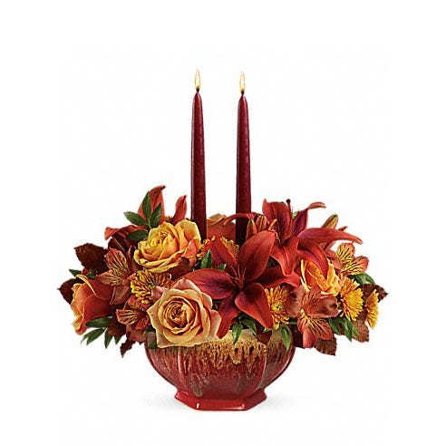 Peach roses, Burgundy lilies and candles create a rustic centerpiece