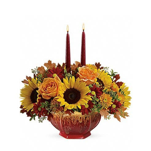 Sunflower, orange roses, and candle flowers centerpiece with octagon vase