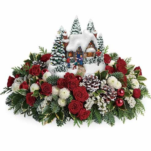 Thomas Kinkade flower arrangement using christmas flowers and red roses