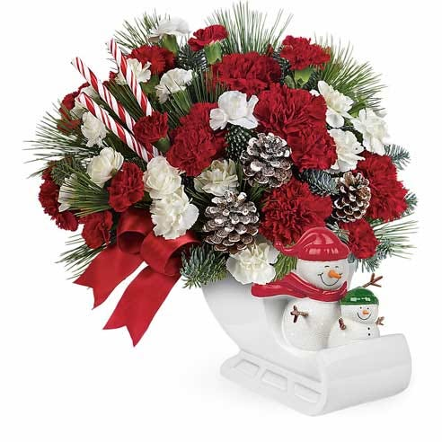 Sleigh snowman flower arrangement with sleigh flower vase and carnations
