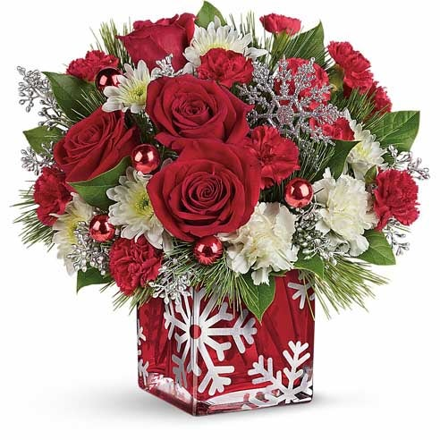 Christmas flowers bouquet with red roses, red carnations with christmas flower vase