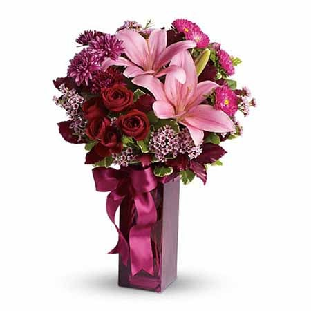 Pink lily bouquet of cheap flowers with burgundy vase, red roses and pink carnations