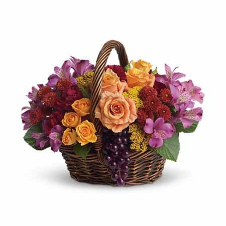 Flowers and grape basket from send flowers with orange roses and purple flowers