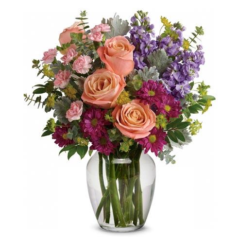 Mixed bouquet of flowers in a vase with pale pink roses, a vintage flower bouquet