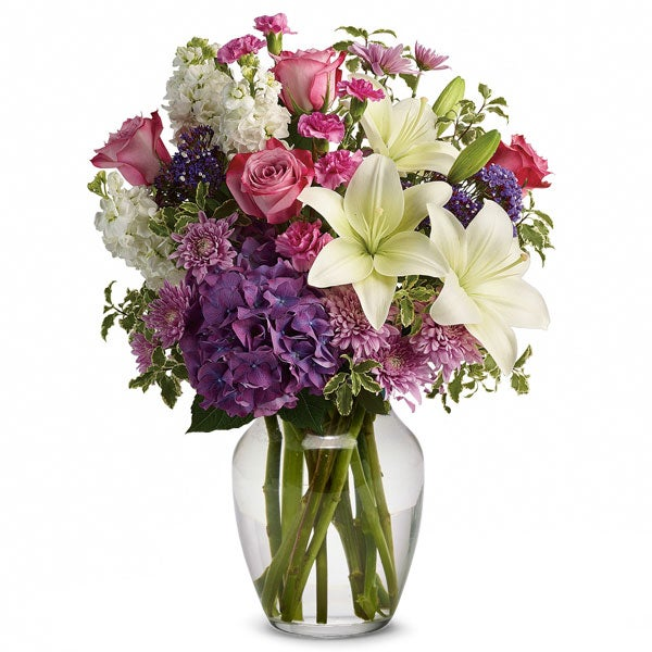 White lily flower delivery in a glass vase with white lily, pink roses and cheap flowers
